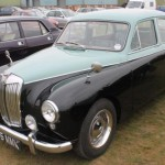 MG Magnette in a fetching two-tone paintjob and slightly dubious polished wheels.