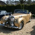 Gold Triumph Roadster. No Bergerac references, please
